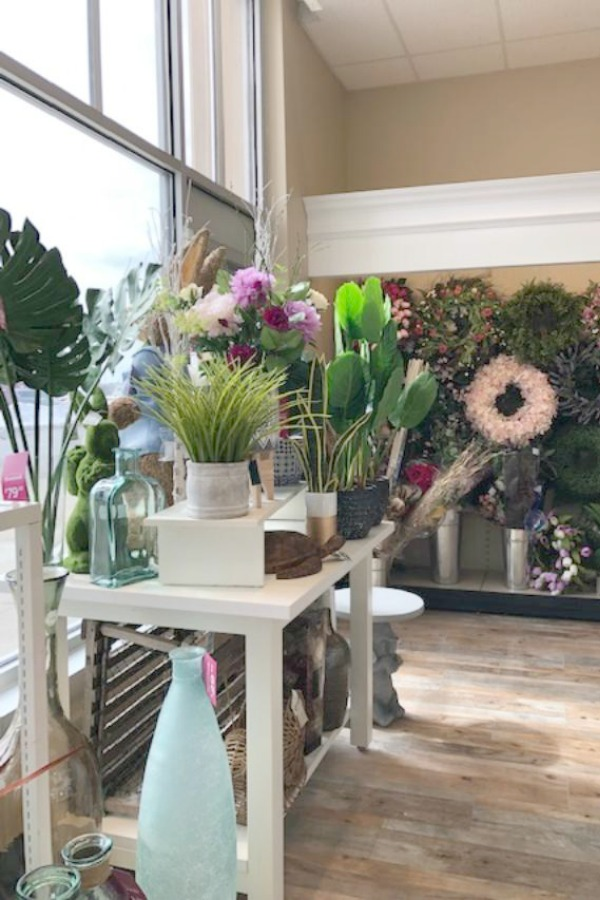 Everlasting flowers and greenery in a shop. French Farmhouse Decor & Lightening Up for Spring - Hello Lovely Studio.