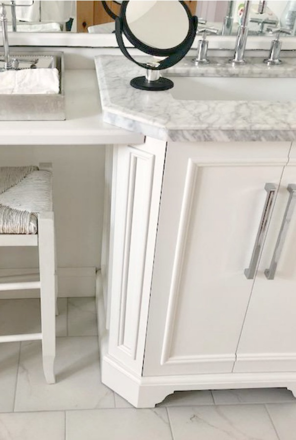 Classic white traditional bathroom design with carrara topped vanity and Kohler Purist bathroom faucet - Hello Lovely Studio.