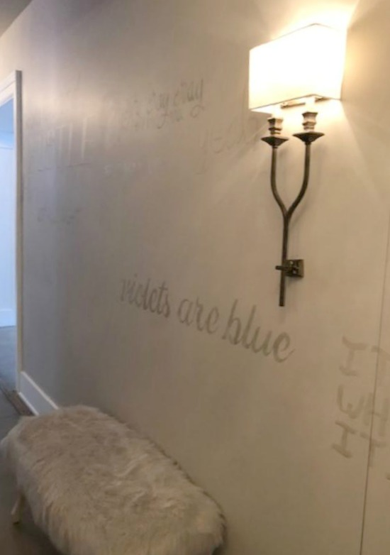 Whimsical script painted in a hallway at RH Gallery Chicago. Come tour photos of Restoration Hardware: Romantic French Decor Ideas on Hello Lovely Studio.