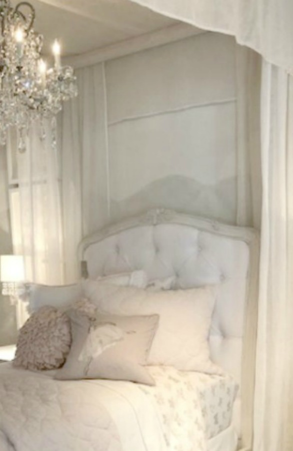 Muted tones in a RH child's French bedroom with beautiful romantic tufted headboard and canopy. Come tour photos of Restoration Hardware: Romantic French Decor Ideas on Hello Lovely Studio.