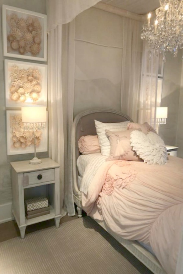 Romantic canopy bed and pink bedding by RH at the gallery in Chicago. Photo: Hello Lovely Studio.
