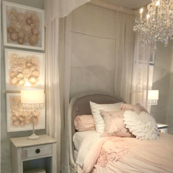 Beautiful French children's bedroom with pink accents, RH. Photo: Hello Lovely Studio. Come tour photos of Restoration Hardware: Romantic French Decor Ideas on Hello Lovely Studio.