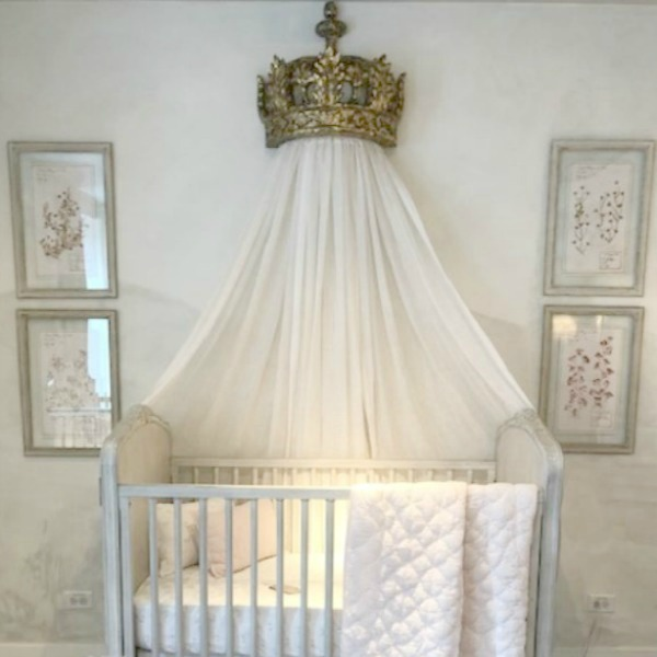 Magnificent Louis style French decor in a white nursery with canopy bed crown and furnishings by RH. Come tour photos of Restoration Hardware: Romantic French Decor Ideas on Hello Lovely Studio.