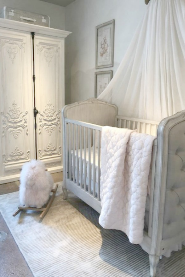 White nursery in a RH Child French inspired moment at RH Gallery Chicago. Photo: Hello Lovely Studio. Come tour photos of Restoration Hardware: Romantic French Decor Ideas on Hello Lovely Studio.