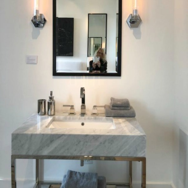 Modern console sink with marble top and metal legs from RH. Photo: Hello Lovely Studio.