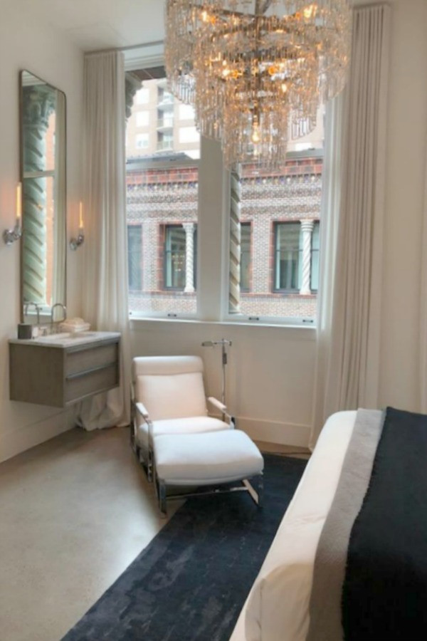 Spectacular view of architecture through a window at RH Gallery Chicago. Come tour photos of Restoration Hardware: Romantic French Decor Ideas on Hello Lovely Studio.