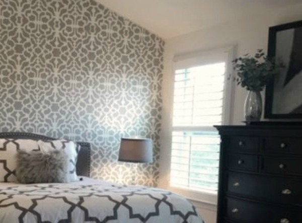 Benjamin Moore San Antonio Gray used as a paint color accent on a dramatic stenciled bedroom wall. Come visit: How to Accent Walls 3 Ways With One Paint Color on Hello Lovely Studio.