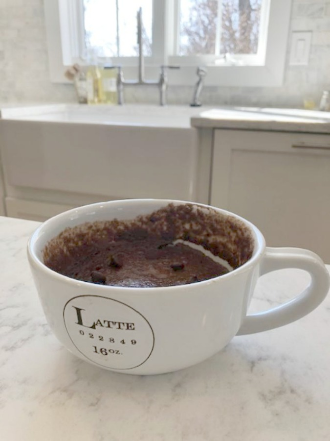 My Chocolate Minute Mug Cake in a latte mug in the kitchen - Hello Lovely Studio.