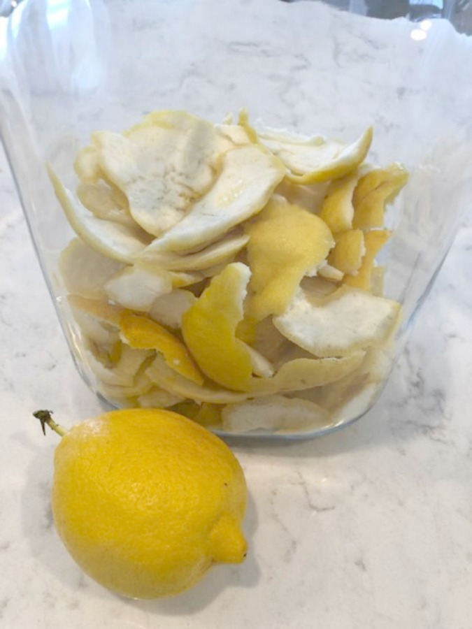Glass jar of lemon peels ready for a limoncello recipe by Hello Lovely Studio. Countertop material is Viatera Minuet quartz.