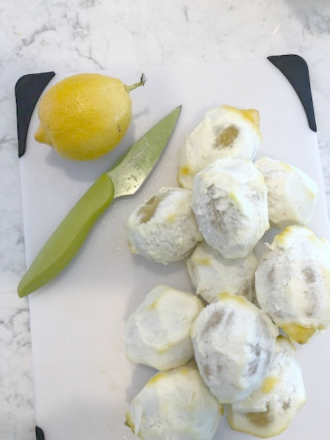 Photos of peeled lemons in preparation for limoncello recipe on Hello Lovely Studio.