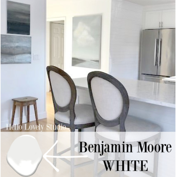 Our white Shaker style kitchen is painted Benjamin Moore WHITE (Yep, just White is the name) - Hello Lovely Studio. #brightwhites #paintcolor #benjaminmoorewhite
