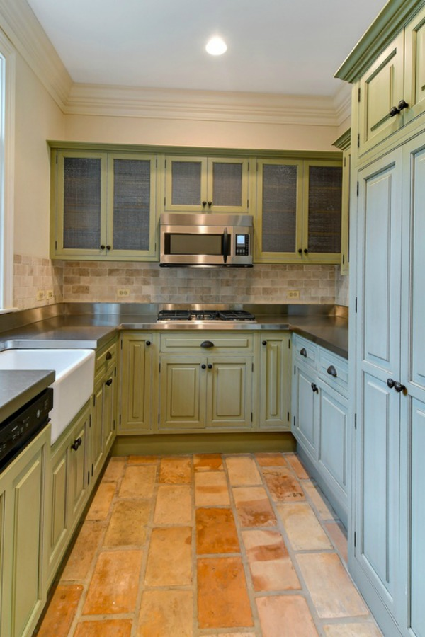 French farmhouse style in a scullery or pantry with beautiful terracotta stone floor in a grand Hinsdale home.