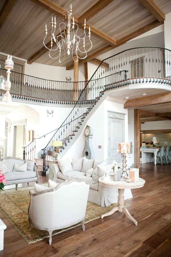 Magnificent French country living room with dramatic wrought iron staircase - Decor de Provence.