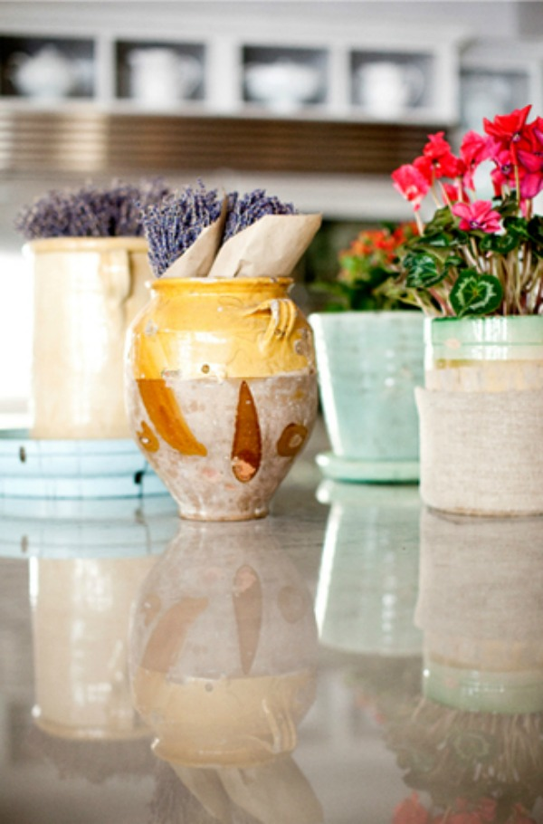 French country earthenware pots, lavender, and rustic elegant decor on a kitchen counter - Decor de Provence.