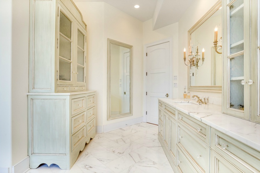 Luxurious white marble bathroom and pale glazed cabinets in a magnificent French Country home. Realistic Country French Decor from Luxurious Ideas...certainly lovely indeed. Decorating ideas for French country style rooms as well as shopping resources.