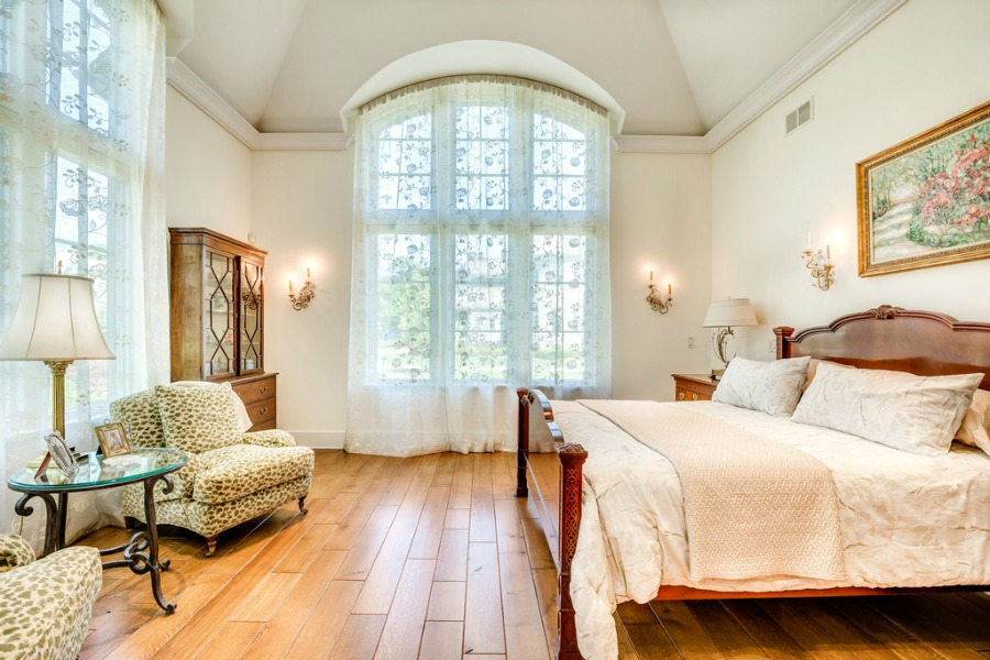 Romantic French country bedroom with arched windows. Realistic Country French Decor from Luxurious Ideas...certainly lovely indeed. Decorating ideas for French country style rooms as well as shopping resources.