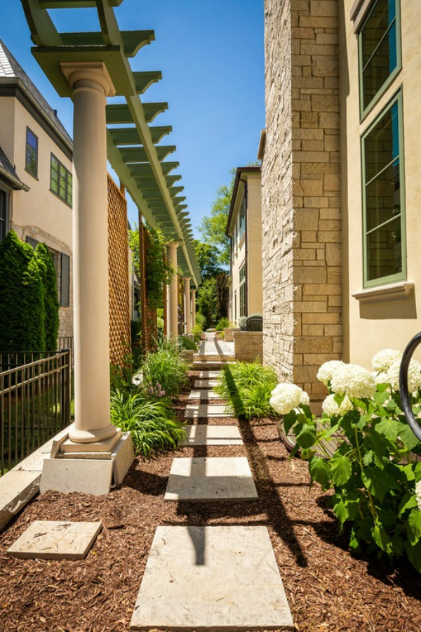 Landscaping detail with mulch, pavers, and hydrangea outside a grand French home in Elmhurst, IL.