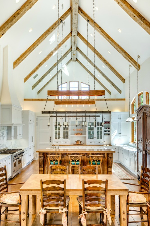 Magnificent lofty ceiling in a kitchen of a French country home with an abundance of warm natural wood and white cabinetry. Realistic Country French Decor from Luxurious Ideas...certainly lovely indeed. Decorating ideas for French country style rooms as well as shopping resources.