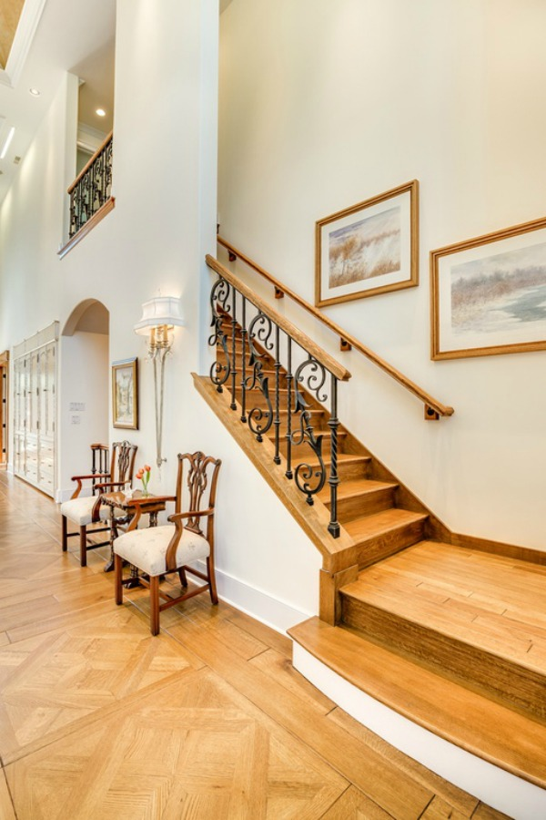 Beautiful oak hardwood flooring in an entry and stairs in a grand French country house in Elmhurst, IL.