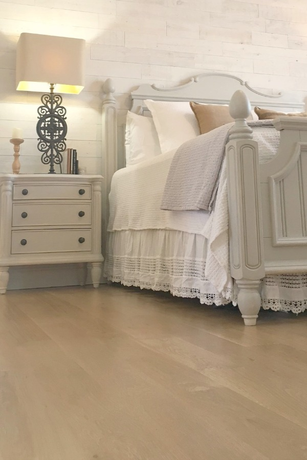My serene Nordic French style bedroom with Benjamin Moore White walls and Stikwood accent wall. Hello Lovely Studio.