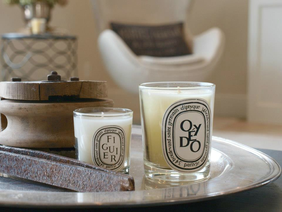 A silver tray with rustic objects and Diptyque candles in our Belgian style living room. Hello Lovely Studio. Come discover more inspiring trays for layering and vignettes in Adding Tray Très Chic to Your Home.