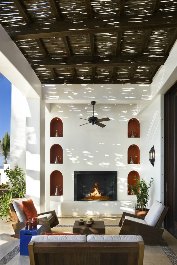 Luxurious loggia with fireplace and arches by Ike Kligerman Barkley