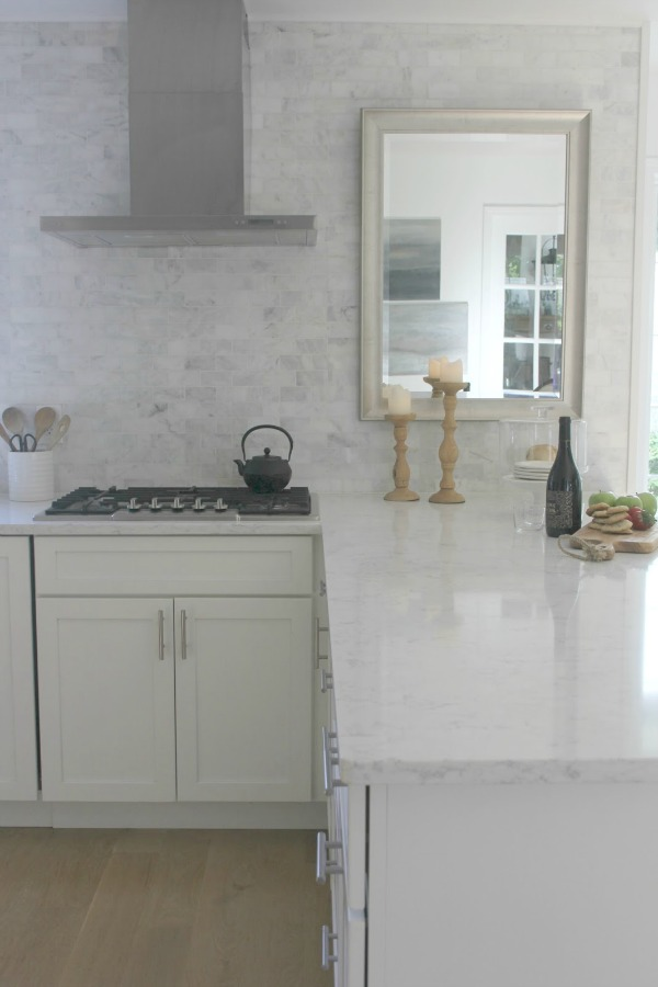 Classic white kitchen with Viatera quartz countertop (Minuet) and Shaker style cabinetry - Hello Lovely Studio.