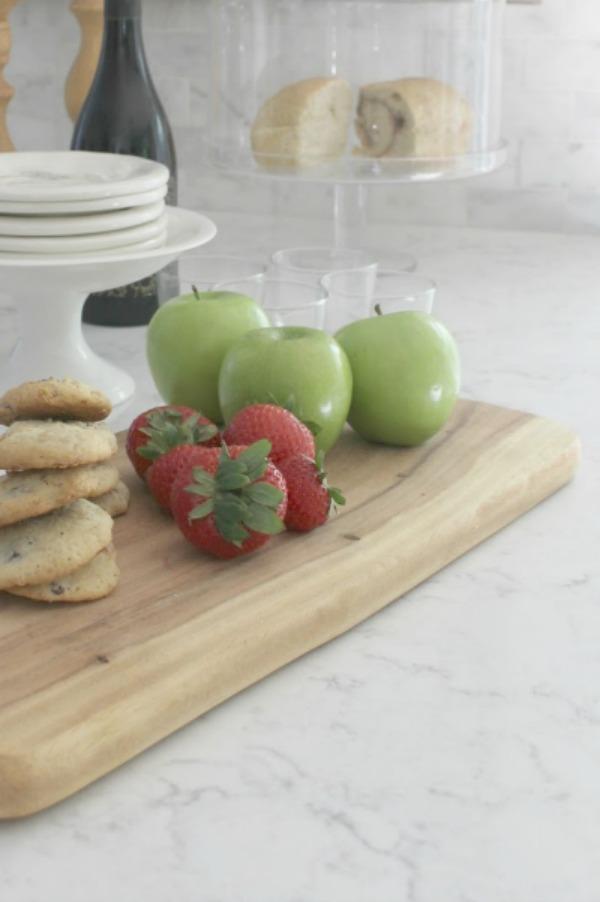 White kitchen with Viatera Minuet quartz countertops - Hello Lovely Studio.