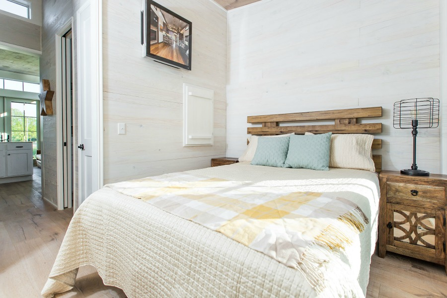Tiny house beautiful! This saltbox style designer cottage by architect Jeffrey Dungan is offered at The Retreat by Oakstone.