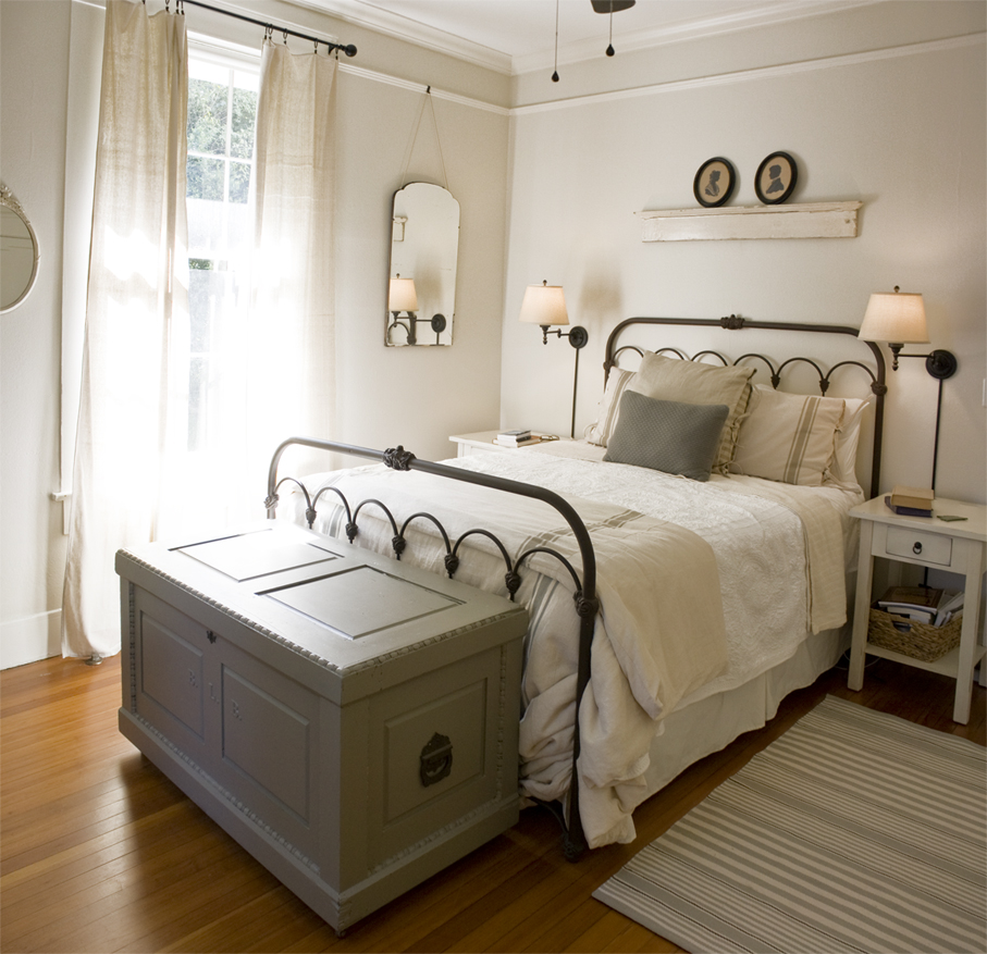 Erin Napier designed cottage style bedroom with Sherwin Williams Dover White paint on walls.