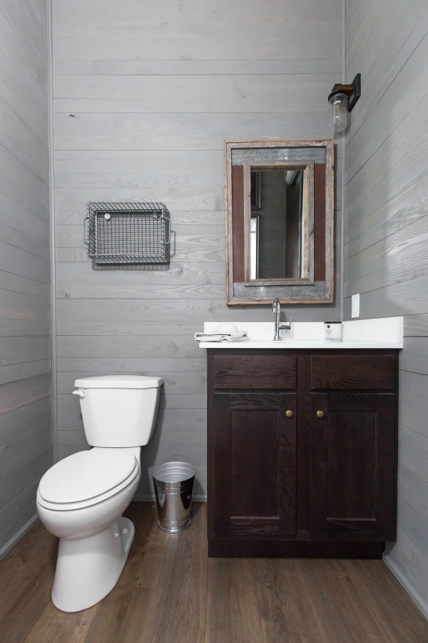 Bathroom with shiplap in tiny house designed by Jeffrey Dungan, an exquisitely crafted luxurious Low Country style Designer Cottage at The Retreat at Oakstone.