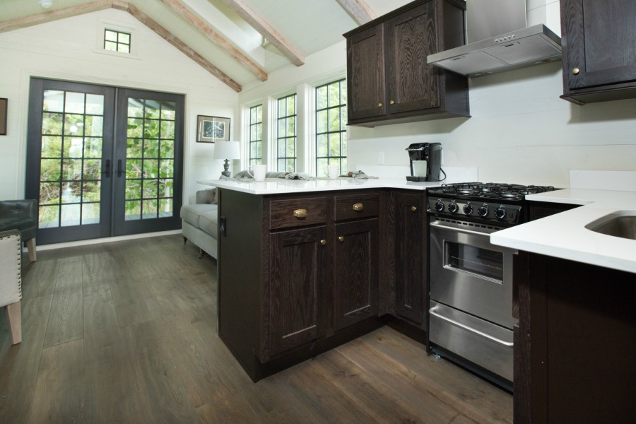 Tiny house kitchen design by Jeffrey Dungan, an exquisitely crafted luxurious Low Country style Designer Cottage at The Retreat at Oakstone.