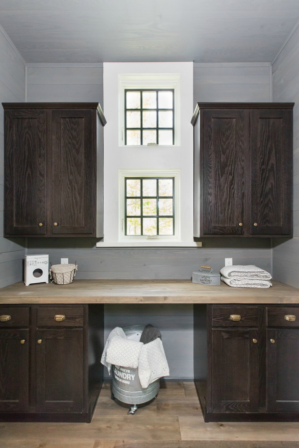 Laundry room with butcher block counter in tiny house designed by Jeffrey Dungan, an exquisitely crafted luxurious Low Country style Designer Cottage at The Retreat at Oakstone.