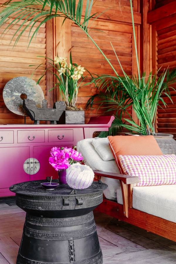 Tropical splendor and magenta pop in this outdoor design moment by Tom Stringer.