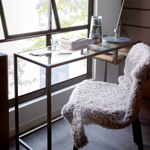 Cozy vignette with Ikea Vittsjo laptop table and a fleecy covered chair. Jornalogora.