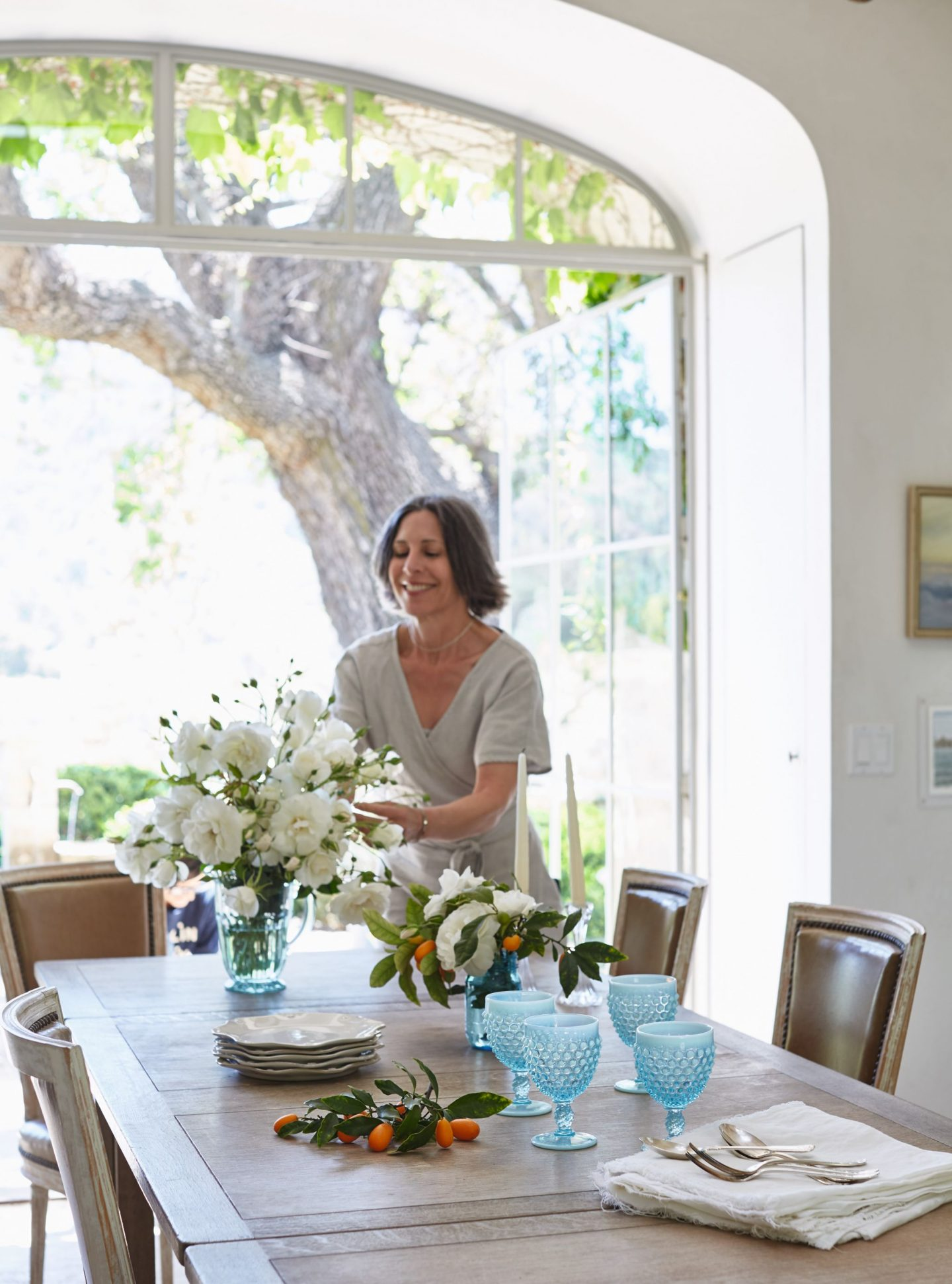 Patina Farm dining room with a magnificent view to an ancient oak and gardens. Brooke Giannetti and Steve have designed a dreamy lifestyle! #patinafarm #diningroom #giannettihome #modernfarmhouse #europeanfarmhouse #europeancountry #interiordesign