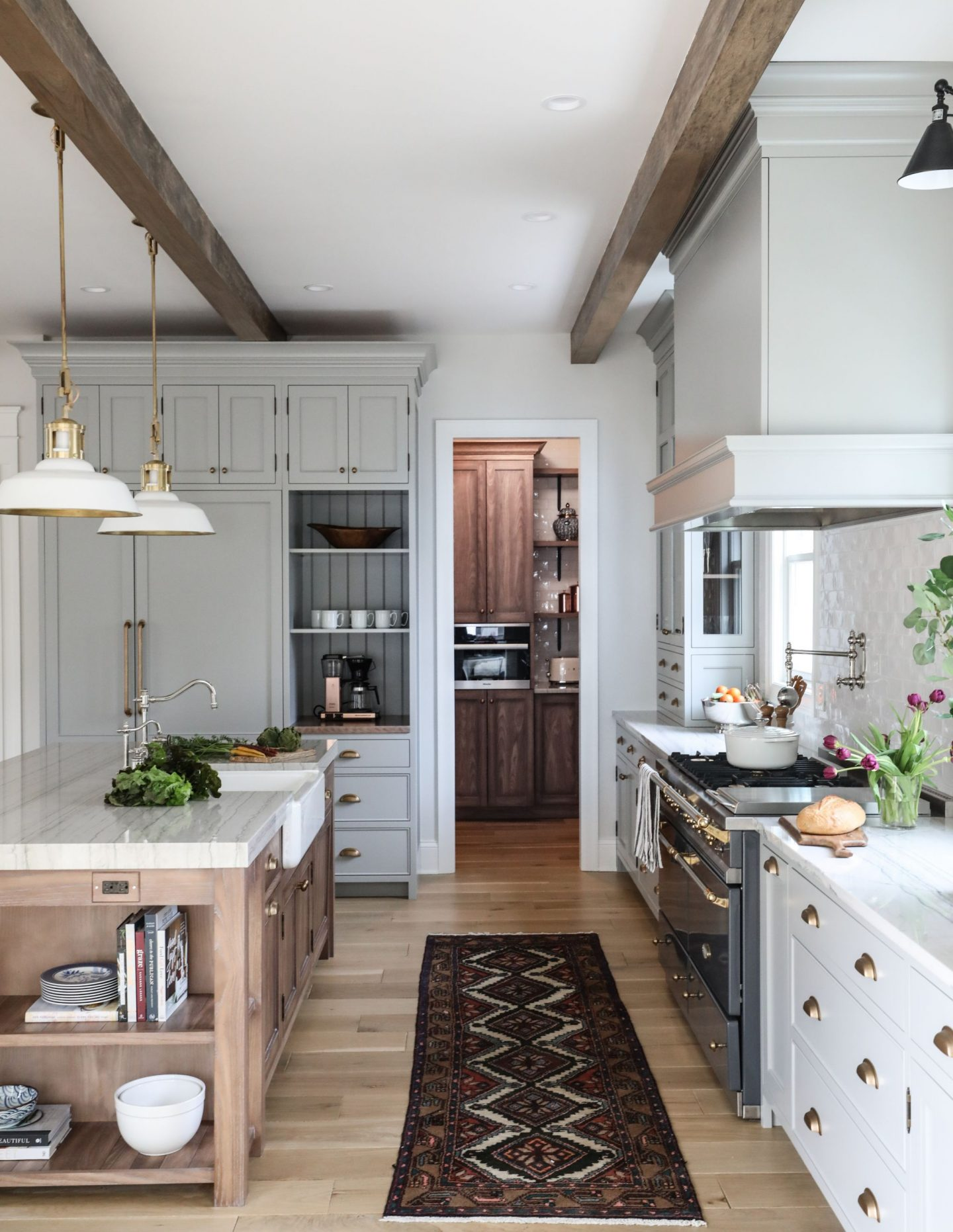 Lamp Room Gray Farrow & Ball painted cabinets in a timeless and classic kitchen by Park and Oak. Click through for Perfect Light Gray Paint Colors You'll Love as Well as Interior Design Inspiration Photos.