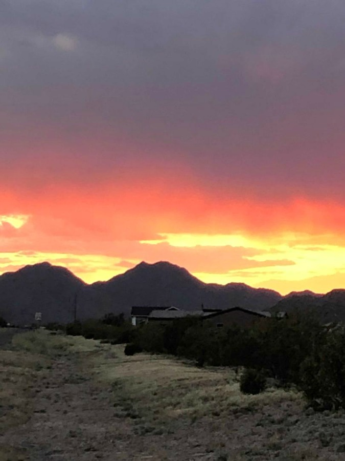 Pink and orange Arizona sunset over mountains - Hello Lovely Studio.
