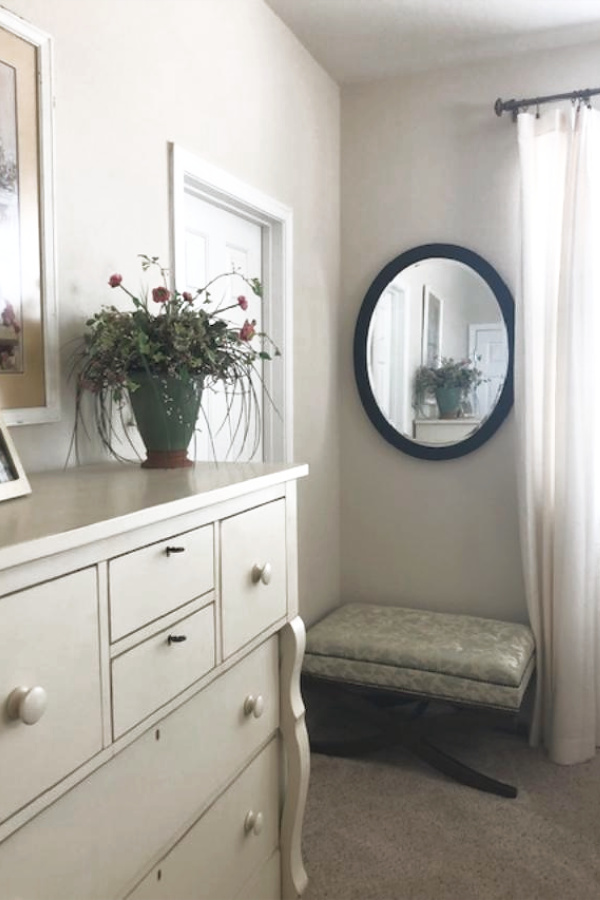 Benjamin Moore White Sand in a traditional style bedroom with Shaker dresser. #paintcolors #benjaminmoore #whitesand #whitepaintcolors #warmwhite #interiordesign
