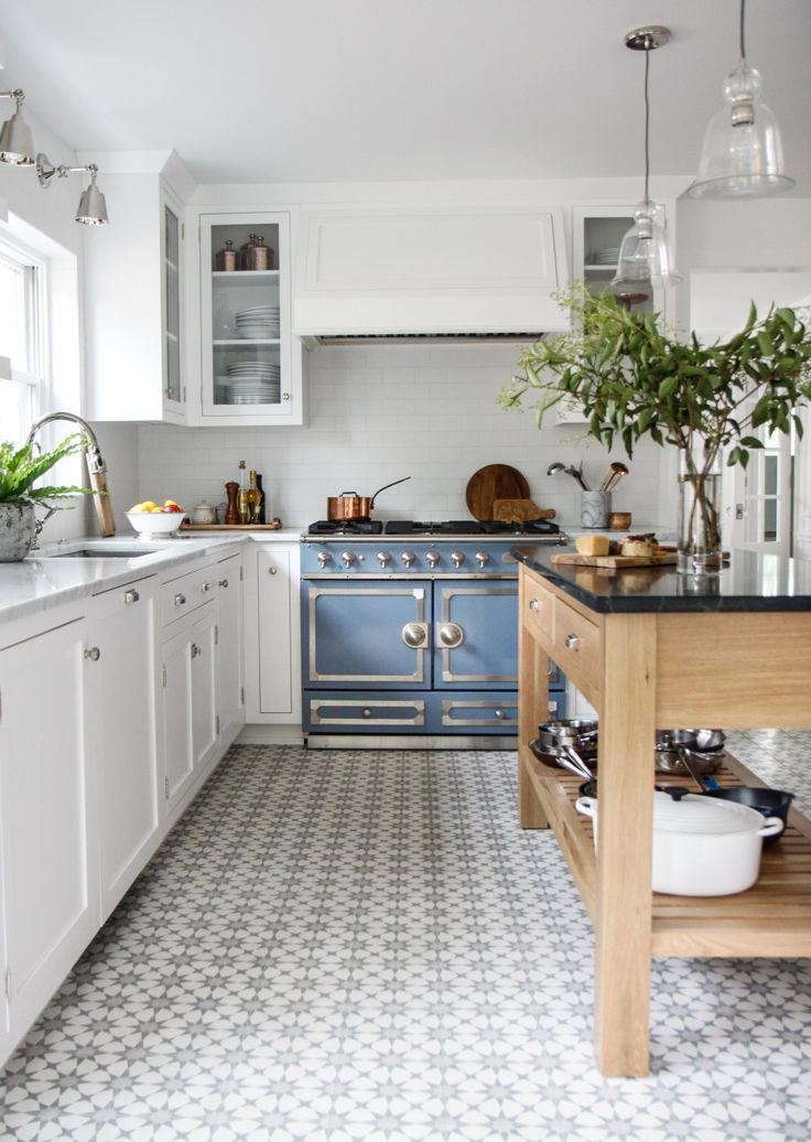 Gorgeous classic white kitchen with blue French range and cement tile in blue grey. Park & Oak.