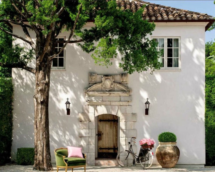 Gorgeous white stucco French farmhouse inspired house exterior with tile roof - Reagan Andre. #pamelapierce #reaganandre #frenchfarmhouse #houseexterior #housedesign #whitestucco