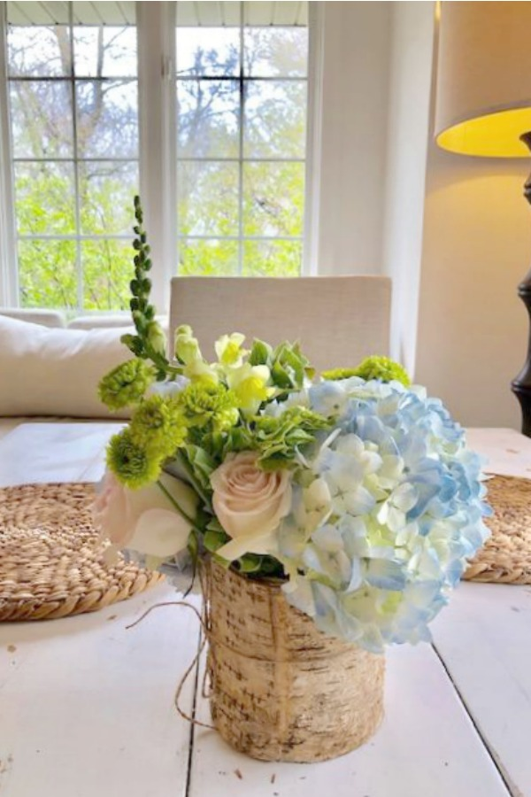 Spring floral arrangement on my kitchen table with blue hydrangea, blush pink roses, and greenery. Hello Lovely Studio.