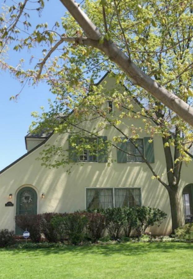 Lovely vintage home exterior in Spring. Hello Lovely Studio.
