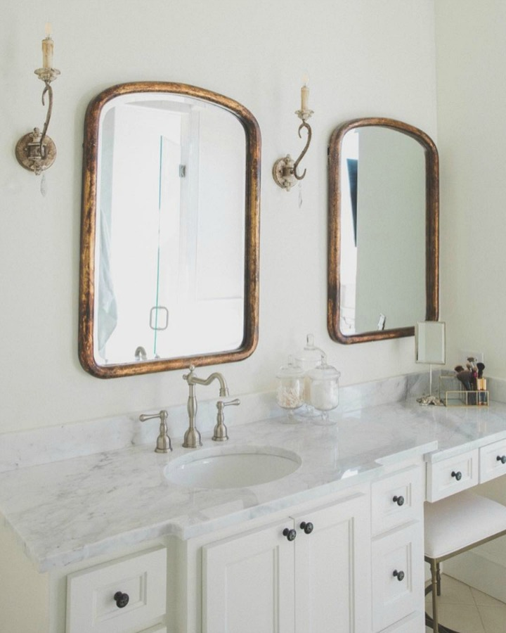 French country farmhouse bathroom with Sherwin Williams Alabaster paint color on walls. Brit Jones Design. See 18 Inspiring Country French Bedroom Decor Ideas!