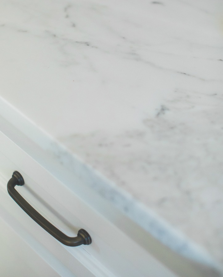 Detail of honed arabescato marble countertop in French country kitchen by Brit Jones.
