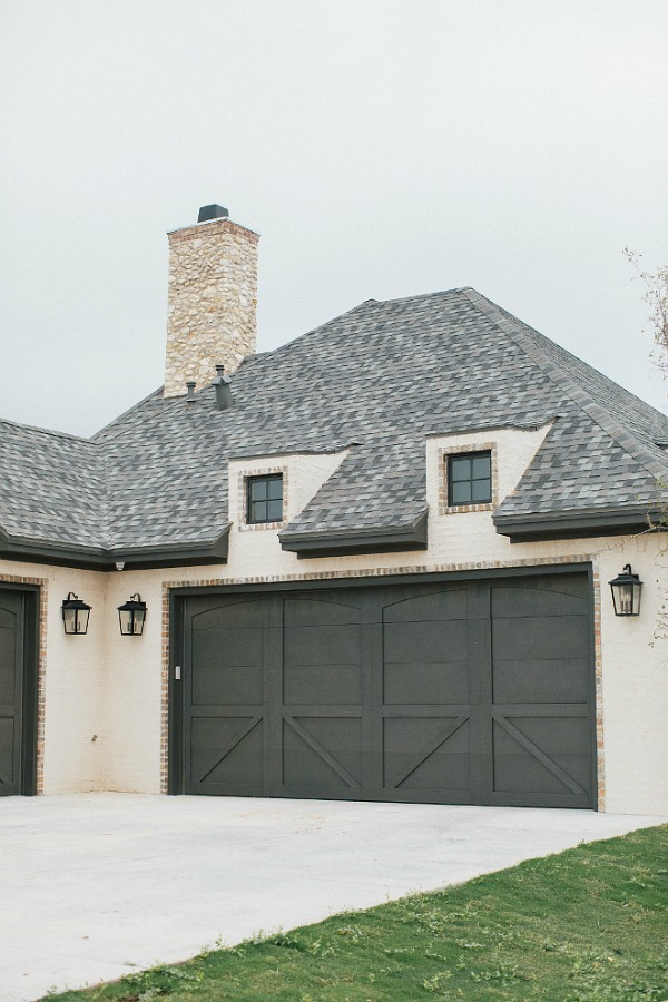 Detail of garage, dormers, and roof on new construction French country home. Brit Jones Photography.