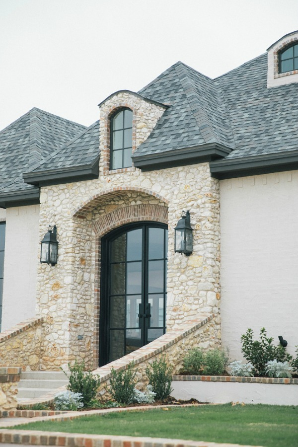 Detail of brick and stone on French country new house exterior. Brit Jones photography.