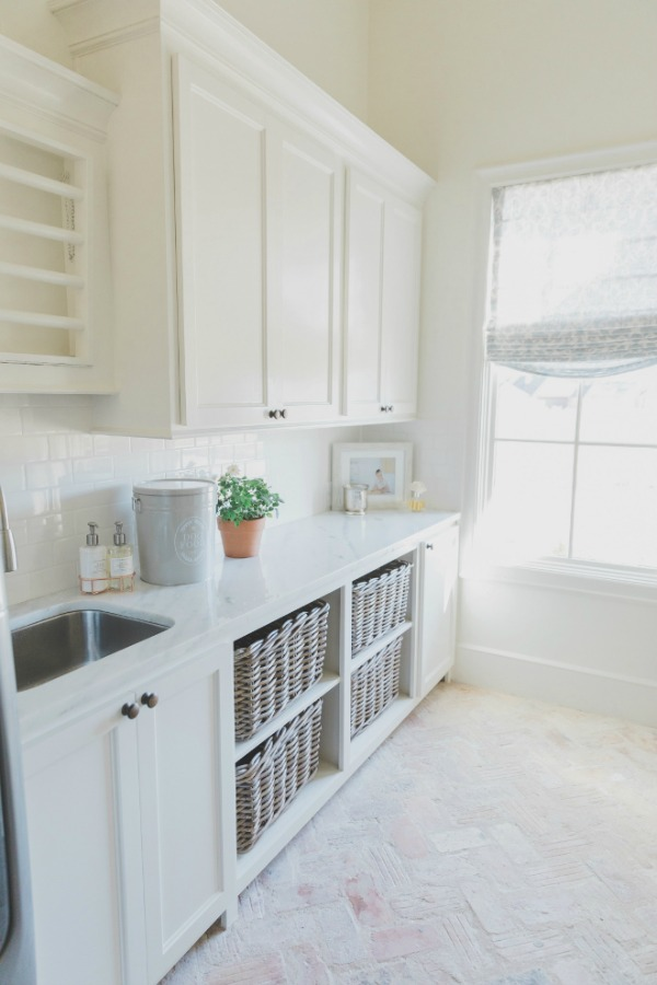 A charming French country laundry room in a newly constructed home with Old World style and a soft color palette. Brit Jones Design. Come enjoy more Dreamy Laundry Room Inspiration to Re-imagine a Timeless Tranquil Design!