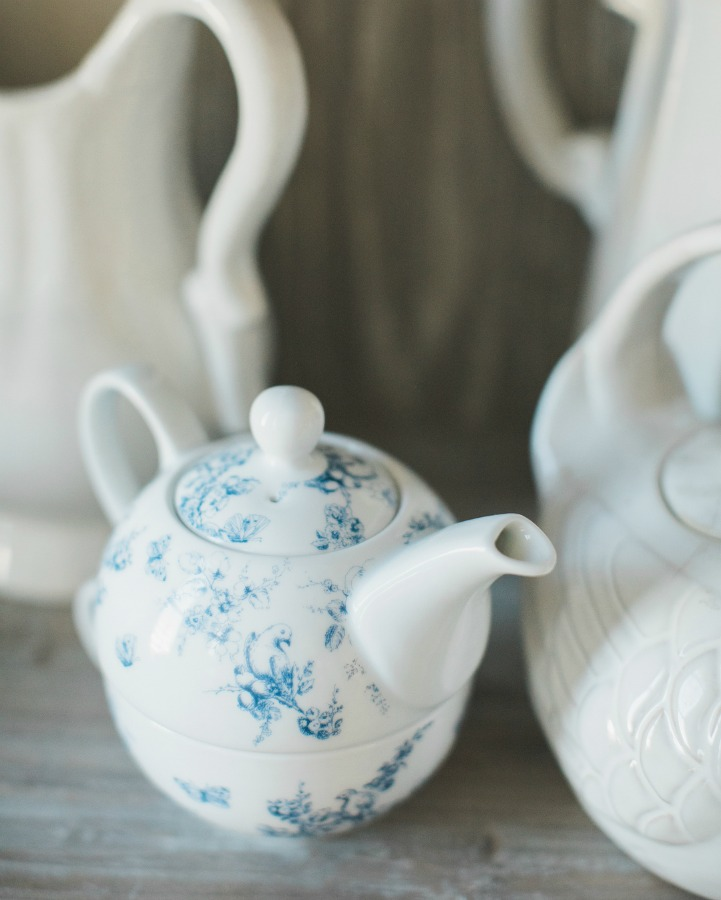 White and blue teapot and white ironstone vignette in a French country home. Brit Jones Design.