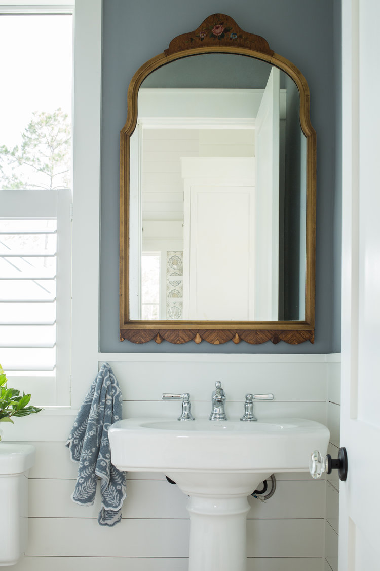 Coastal cottage bathroom with pedestal sink. Design: Lisa Furey.